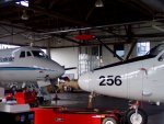 The G-1 (left) and the Twin Otter, nose to nose in the hangar.