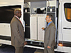 Craig Nelson, right, shows radiation detection equipment inside a specially equipped van an attendee at an INTERPOL conference in May.