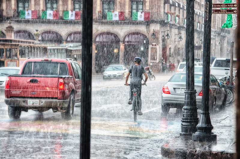 biking through a city in a downpour