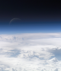 satellite view of top of atmosphere with moon