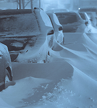 cars covered with snow drifts during cold snap
