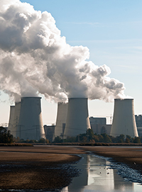 cooling towers of coal-fired power plant near river