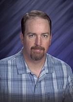 Portrait of Ron Moore
