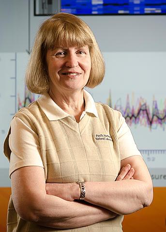 Karin Rodland standing in a lab