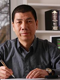 Jun Liu at desk