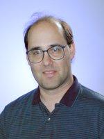 Portrait of Greg Schenter