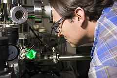 Danny Perea looks into an atom probe