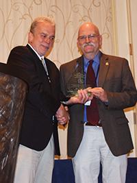 Dr. Charles Peden accepting award