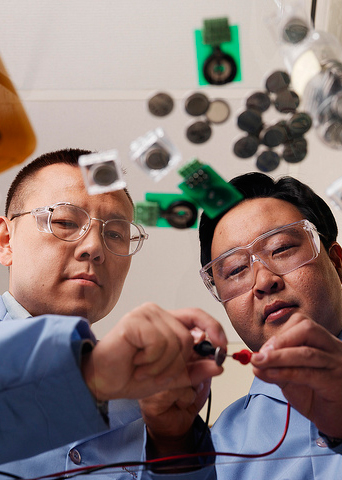 Researchers studying batteries
