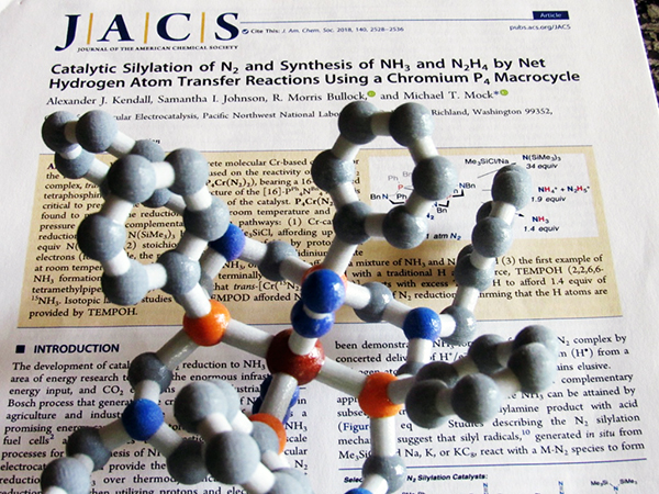 3D model of chromium catalyst resting on JACS paper