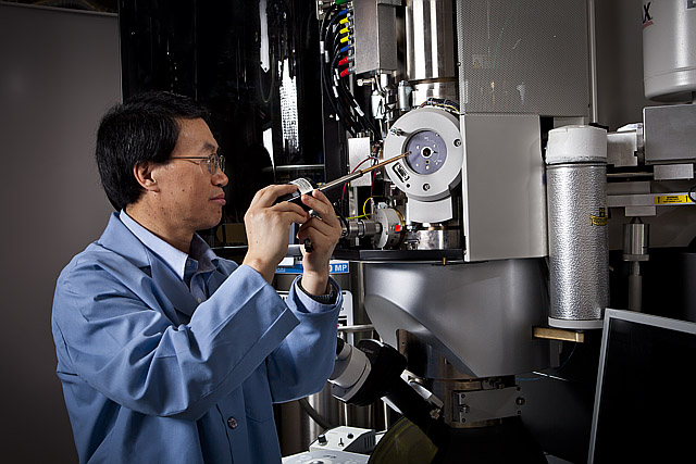 Scientist working on instrument