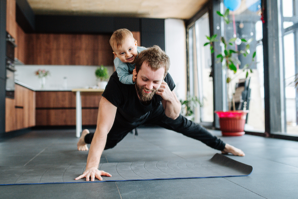 dad doing pushup with child on his back
