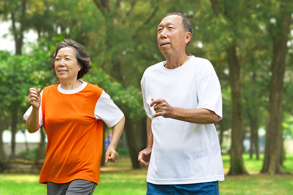 an older man and woman running