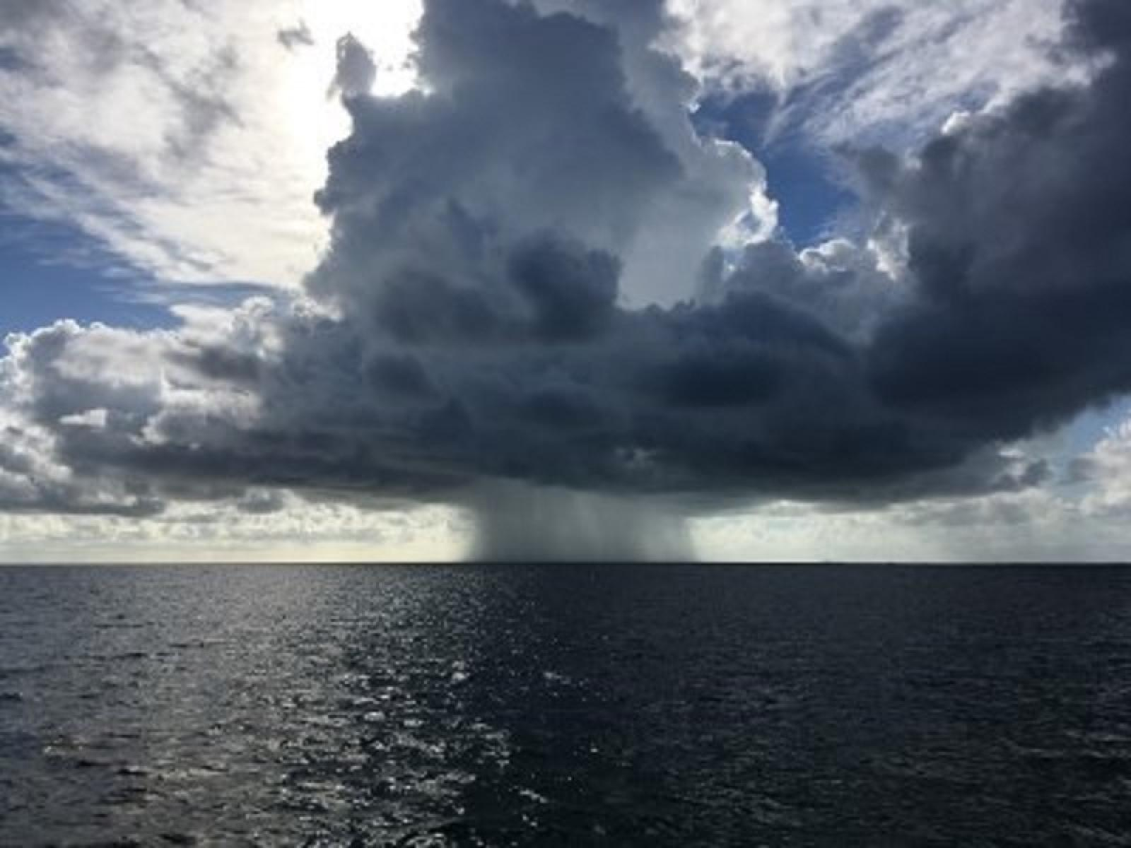 Rain shaft over ocean