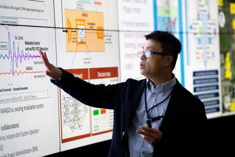 Electrical engineer Qiuhua Huang and his colleagues at PNNL are conducting research and developing technologies to enhance the resilience of the nation's electric grid.
