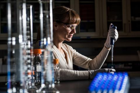 Jennifer Kyle at work in a laboratory at PNNL. Kyle and colleagues studied the lipids in blood samples from Ebola patients to understand how the virus affects patients.