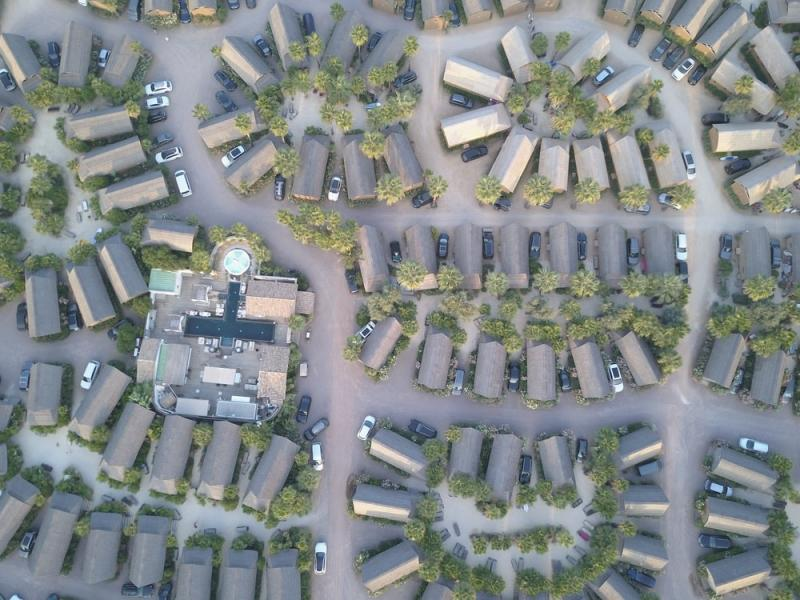 Aerial view of houses and cars in a subdivision