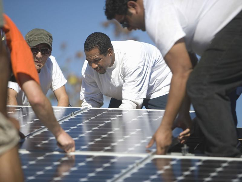 Group installs solar panels.