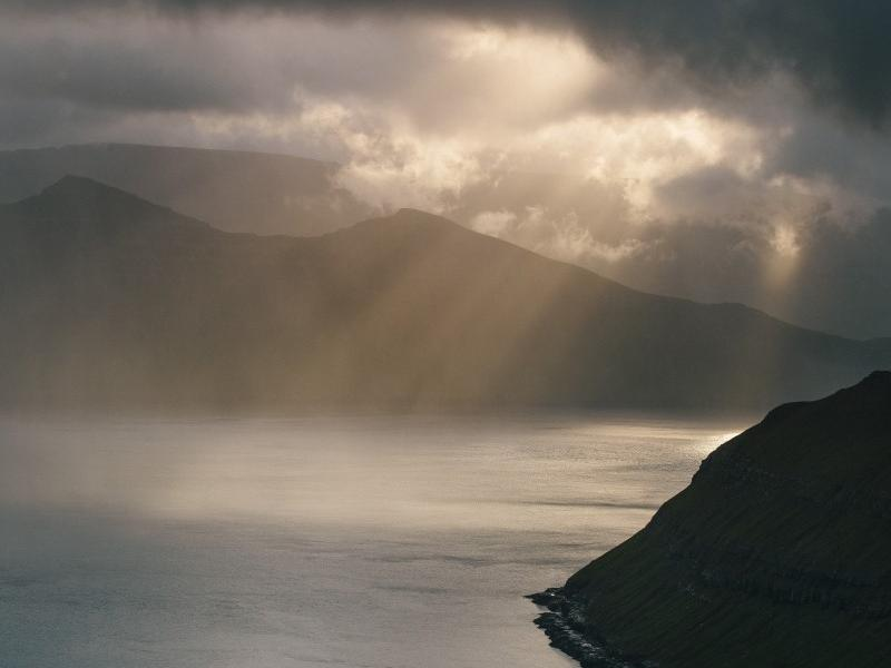 Faroe Islands clouds and sun rays
