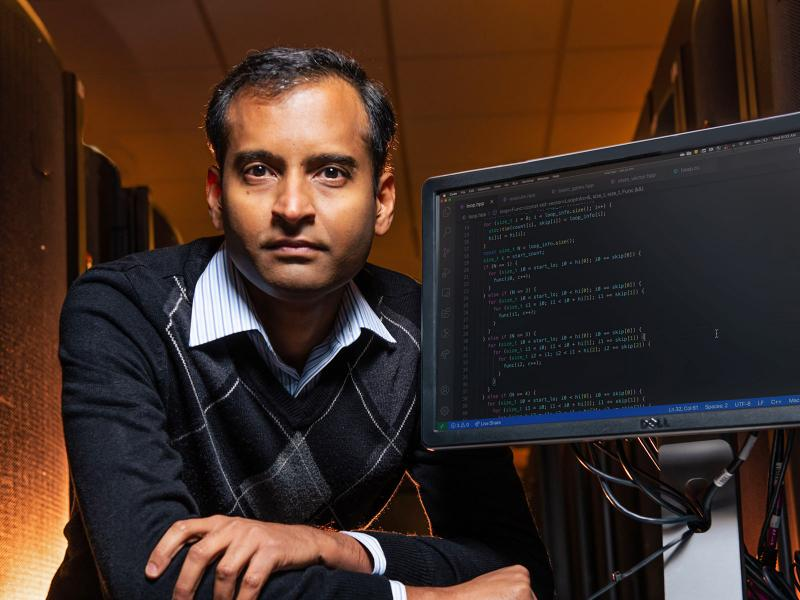 Sriram Krishnamoorthy poses with PNNL supercomputer