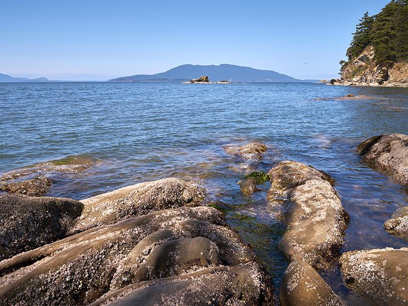 Rocky shoreline looking into Samish Bay near Bellingham, Wash.
