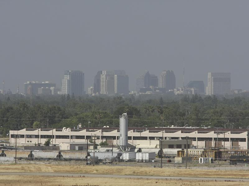 Haze obscures the Sacramento skyline