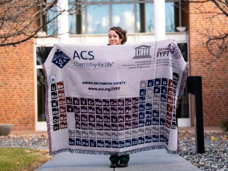 Palazzo holding a blanket showing the periodic table of the elements
