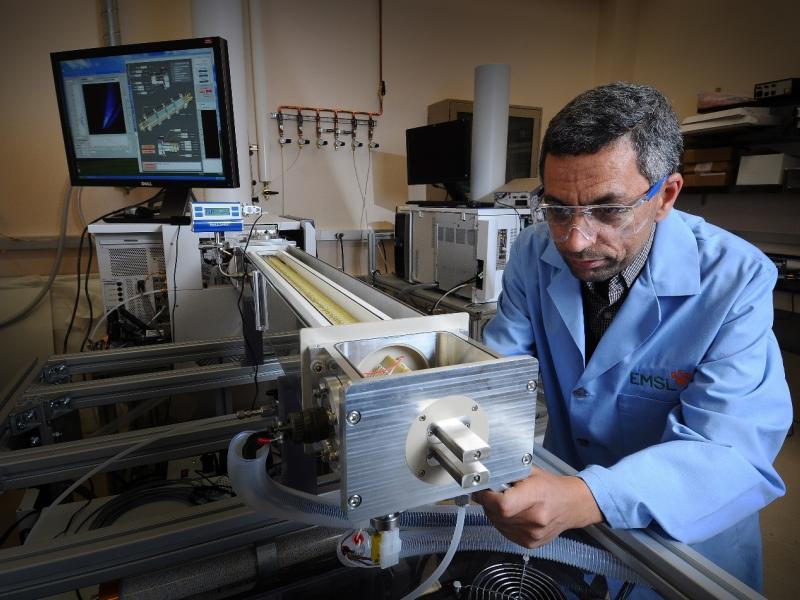 In this 2010 photo, inventive instrument maven Yehia Ibrahim works on a new Ion Mobility Spectrometry-Mass Spectrometry system.